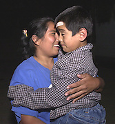 Alvina Villa Zarco, 25, left, reunites with her son, Arturo Carbajal Villa, 5, at Albergue Menor Repatriado in Colonia Buenos Aires in Nogales, Sonora, Mexico.  The shelter houses children unaccompanied by a parent or legal guardian who have been deported from the U.S. after they entered the country illegally.  Border Patrol agents apprehended Arturo, his brother, four juvenile relatives, and their female smuggler in an automobile in Nogales, Arizona.  (PHOTO: NORMA JEAN GARGASZ)