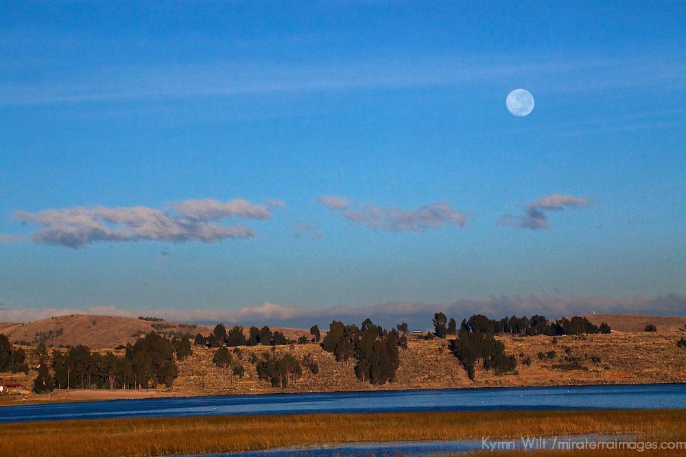 South America, Peru, Laka Titicaca. Full moon (Super moon) over the landscape of Lake Titicaca, Peru.