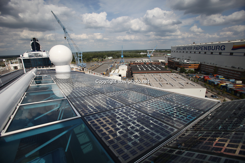 Celebrity Equinox, a brand new cruise ship belonging to Celebrity Cruises, during her river conveyance down the River Emms from the shipyard where she was built to the open sea..Onboard feature photos. (ship unfinished).Solar electricity generators