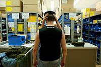 01 JUN 2010, BERLIN/GERMANY:<br /> Ein Wehrpflichtiger bekommt in der Kleiderkammer am ersten Tag nach Ihrer Einberufung zur Bundeswehr ein passendes Barett, Wachbataillon der Bundeswehr, Jukius-Leber-Kaserne<br /> IMAGE: 20100701-01-003<br /> KEYWORDS: Wehrpflicht, Soldaten, Soldat, Bundeswehr