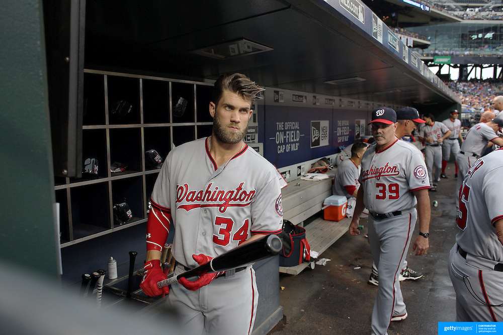 NEW YORK, NEW YORK - July 07: Bryce Harper #34 of the Washington Nationals in the dugout preparing to bat during the Washington Nationals Vs New York Mets regular season MLB game at Citi Field on July 07, 2016 in New York City. (Photo by Tim Clayton/Corbis via Getty Images)