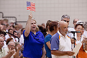 "Aug 10, 2009 -- CHANDLER, AZ: People, most opposed to health care reform, wave American flags during a town hall meeting on health care reform in Chandler, AZ. Rep. Jeff Flake, (R-AZ) hosted a ""town hall"" style meeting on health care reform at Basha High School in Chandler Monday. Flake, a conservative Republican, has opposed President Obama on many issues, like the stimulus and health care reform. Protestors who have shut down similar meetings hosted by Democrats, gave Flake a warm welome.   Photo by Jack Kurtz / ZUMA Press"