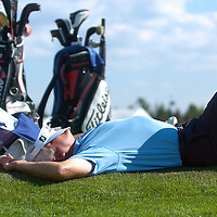 ORIG./Ryan Brennecke/The Bulletin/082010..Bruce Vaughan relaxes with his caddy while waiting to tee off on the 17th hole during The Tradition at Crosswater Club in Sunriver on Friday afternoon.