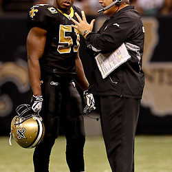 November 21, 2010; New Orleans, LA, USA; New Orleans Saints defensive coordinator Gregg Williams talks with linebacker Jonathan Vilma (51) during the second half against the Seattle Seahawks at the Louisiana Superdome. The Saints defeated the Seahawks 34-19. Mandatory Credit: Derick E. Hingle