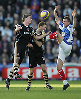 Photo: Lee Earle.<br /> Portsmouth v Charlton Athletic. The Barclays Premiership. 20/01/2007.Pompey's Matthew Taylor (R) goes in high on Matt Holland (L) and Dennis Rommedahl.