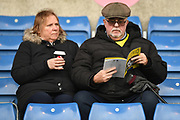 An Oxford United fan reads his programme during the EFL Sky Bet League 1 match between Oxford United and Shrewsbury Town at the Kassam Stadium, Oxford, England on 7 December 2019.