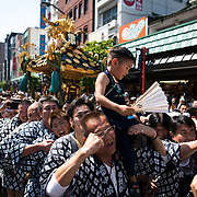 TOKYO, JAPAN - MAY 21: The residents of Asakusa band together to carry a 'mikoshi' (portable shrines) while they chant together during the Sanja Festival in Asakusa, Tokyo on May 21, 2017. These mikoshi is carried in the streets of Asakusa to bring luck, blessings and prosperity to the area and its inhabitants. (Photo: Richard Atrero de Guzman/NUR Photo)