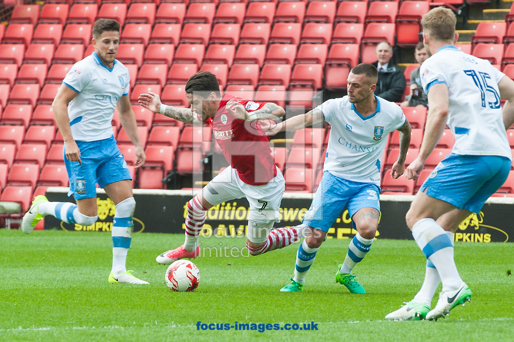 Adam Hammill of Barnsley is fouled by David Jones of Sheffield Wednesday during the Sky Bet Championship match at Oakwell, Barnsley<br /> Picture by Matt Wilkinson/Focus Images Ltd 07814 960751<br /> 01/04/2017