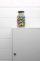 Jar of pills on bathroom cabinet