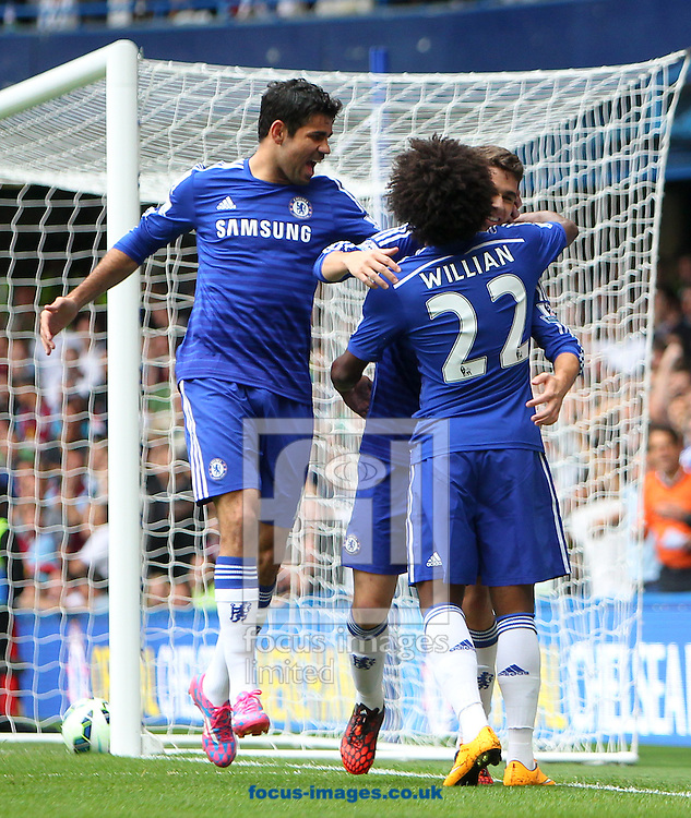 Oscar of Chelsea is congratulated by team-mates Diego Costa and Willian after opening the scoring against Aston Villa during the Barclays Premier League match at Stamford Bridge, London<br /> Picture by John Rainford/Focus Images Ltd +44 7506 538356<br /> 27/09/2014