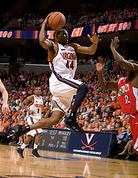 Virginia guard Sean Singletary (44) makes an acrobatic move to the basket against Bradley.  The Virginia Cavaliers fell to the Bradley Braves 96-85 in the semifinals of the 2008 College Basketball Invitational at the University of Virginia's John Paul Jones Arena in Charlottesville, VA on March 26, 2008.