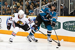 December 11, 2010; San Jose, CA, USA; San Jose Sharks center Joe Thornton (19) passes the puck around Chicago Blackhawks right wing Jack Skille (20) during the second period at HP Pavilion. Mandatory Credit: Jason O. Watson / US PRESSWIRE