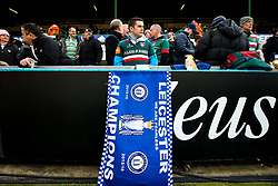 A Leicester Tigers lays out a Leicester City flag at Welford Road in tribute to Leicester City Chairman Vichai Srivaddhanaprabha - Mandatory by-line: Robbie Stephenson/JMP - 03/11/2018 - RUGBY - Welford Road Stadium - Leicester, England - Leicester Tigers v Worcester Warriors - Gallagher Premiership Rugby