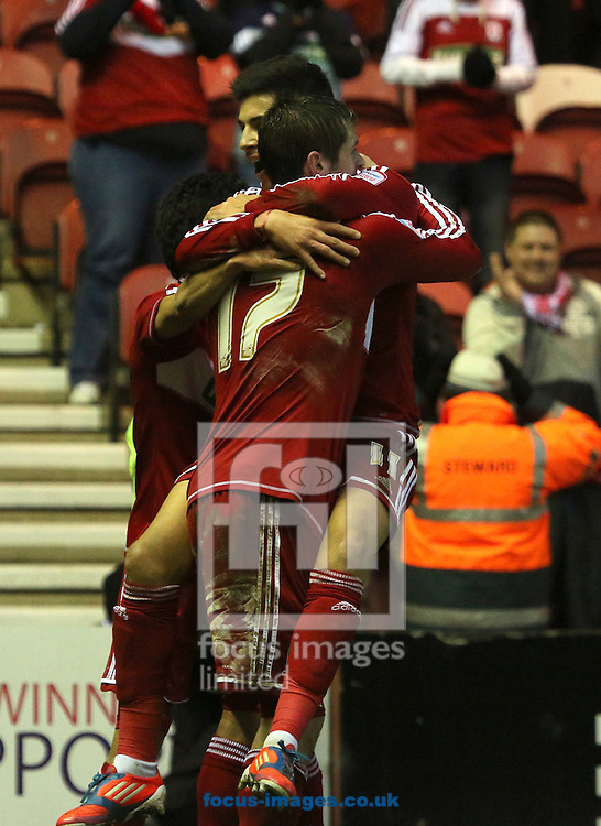 Picture by Paul Gaythorpe/Focus Images Ltd +447771 871632.26/01/2013.Emmanuel Ledesma congratulates Lukas Jutkiewicz of Middlesbrough on scoring the opening goal against Aldershot Town during the FA Cup match at the Riverside Stadium, Middlesbrough.