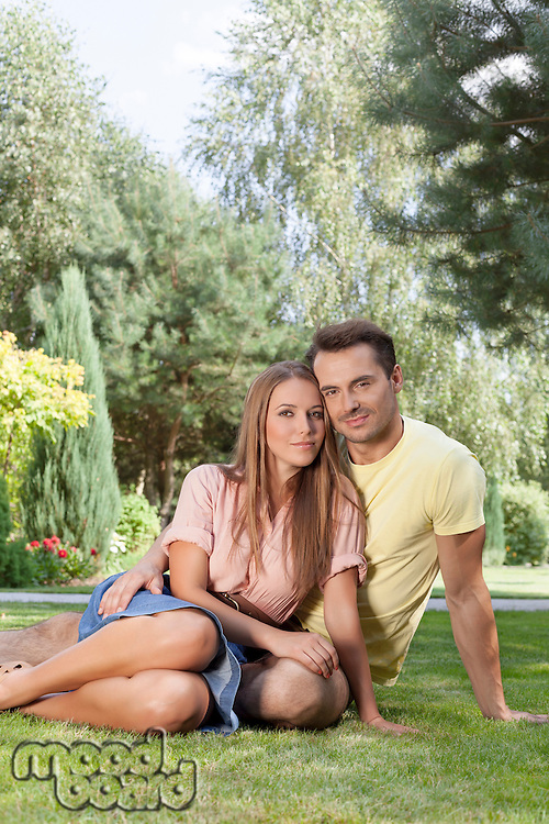 Portrait of young couple spending quality time in park