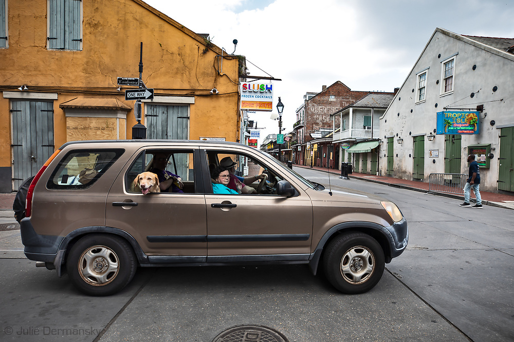 A couple drive slowly down Bourbon Street in New Orleans on March 27, 2020. New Orleans , major city, USA