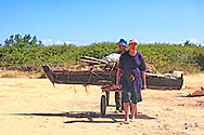 Men with boat in La Coloma, Pinar del Rio, Cuba.