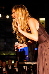 Covent Garden, London, October 30th 2014. Multi-platinum selling artist Joss Stone performs two numbers with legendary guitarist Jeff Beck as part of the events in Covent Garden where London Poppy Day events were held as the Royal British Legion raises funds, with over £1 million expected to be raised. PICTURED: Joss Stone greets the crowd.