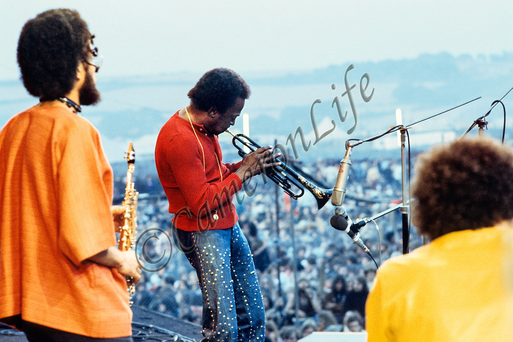 "Miles Davis, Chick Corea and Gary Bartz - 1970 Isle of Wight Music Festival (displayed as a 18x12"" print in the exhibition)"