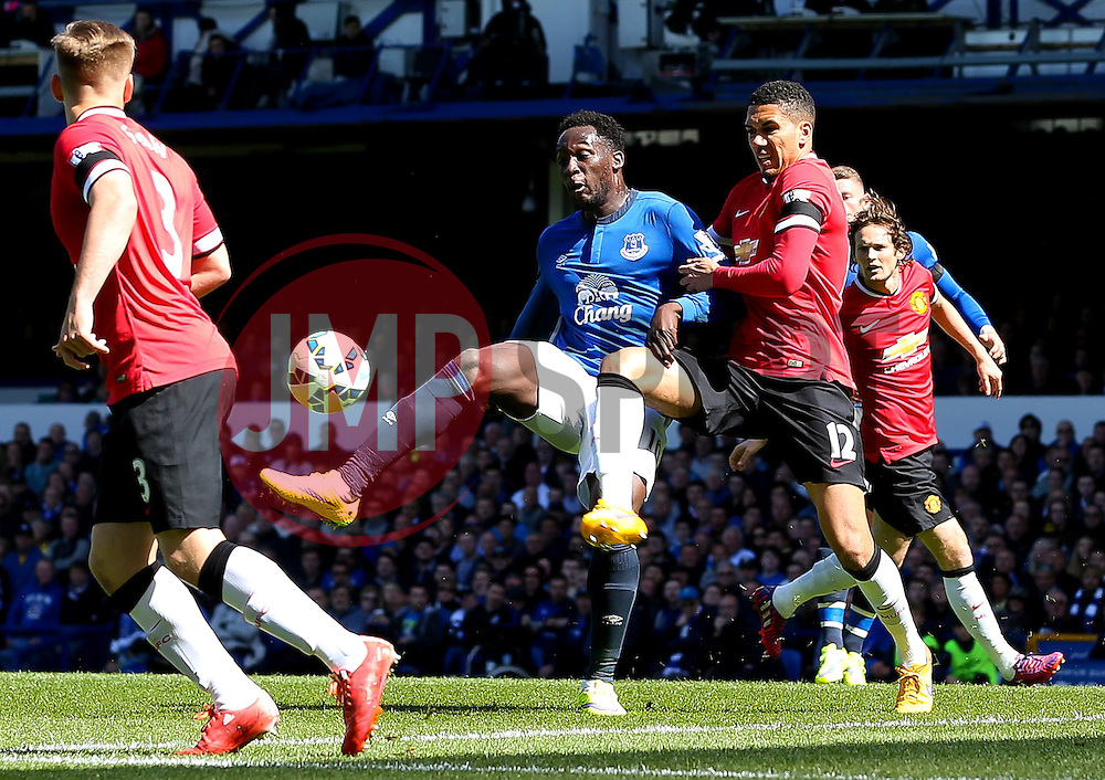 Everton's Romelu Lukaku under pressure from Chris Smalling of Manchester United   - Photo mandatory by-line: Matt McNulty/JMP - Mobile: 07966 386802 - 26/04/2015 - SPORT - Football - Liverpool - Goodison Park - Everton v Manchester United - Barclays Premier League