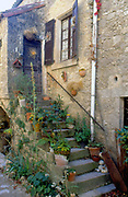 France, Languedoc and Roussillon. Le Couvertoirade.  Rue Droite, steps up to doorway.
