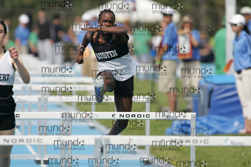 Jenelle McCalla competing in the senior girls 100m hurdles qualifying round at the 2007 OFSAA track and field championships held in Ottawa.