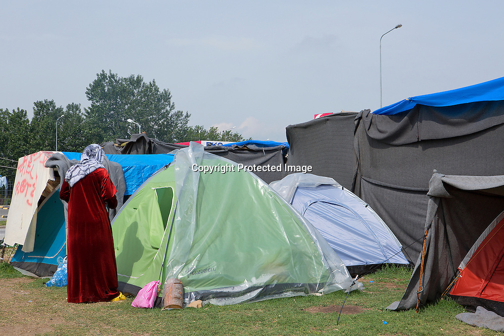 Syrian woman refugees stading outside her tent in Eko station a makeshift camp located near by PolyKastro, Greece where she is living since Macedonia closed the border with Greece.