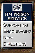 A sign on the wall at the entrance to the prison. HMP Send, closed female prison. Ripley, Surrey.