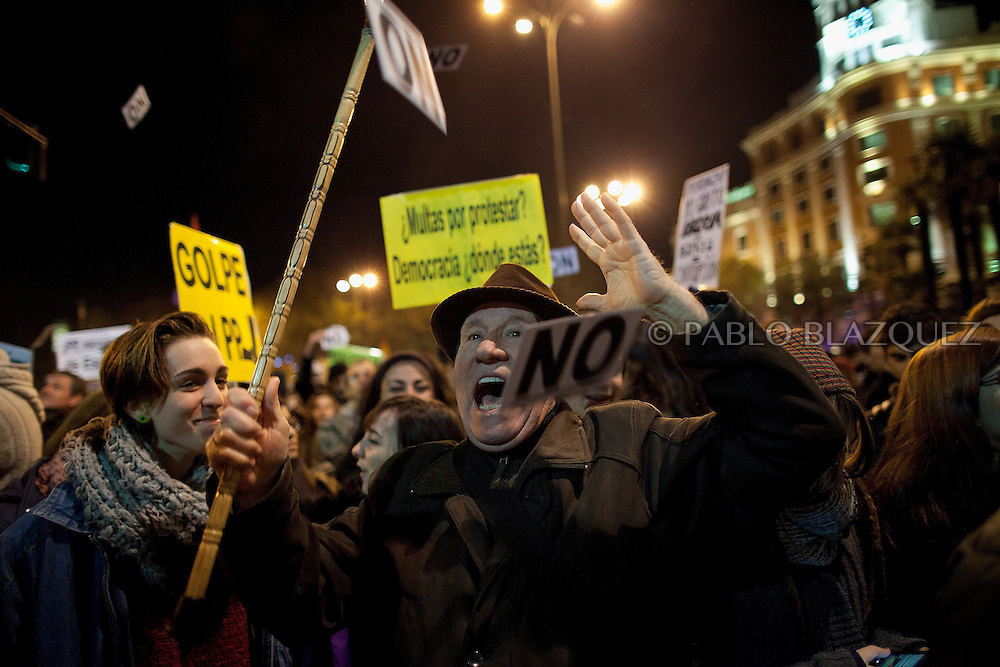 A man shouts slogans during a 'Surrounding the Congress' protest at Neptuno Square on December 14, 2013 in Madrid, Spain. Social movements groups called a 'Rodea el Congreso' 'Surrounding the Parliament' protest in reaction to the financial and social cuts, but also a new law the Spanish government is working that aims to set heavy fines. Around 1,500 policemen were on duty to protect the congress. The bill will set up fines of up to 30,000 euros for offenses related to social movements protests, insulting the state or offending or filming the authorities. After the demonstration some protesters clashed with riot policemen