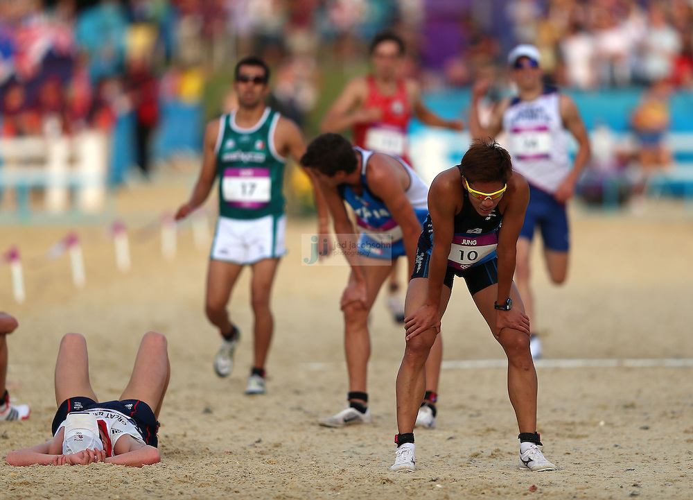 Jinhwa Jung of Korea crosses the finish line after finishing the men's modern pentathlon during day 15 of the London Olympic Games in London, England, United Kingdom on August 11, 2012..(Jed Jacobsohn/for The New York Times)..
