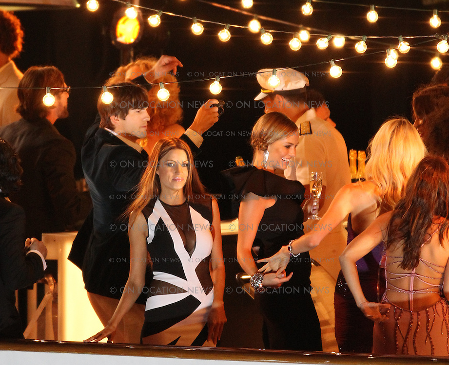 August 21st, 2010 San Pedro, CA. ***EXCLUSIVE*** It's Lights, Camera's and Action for Ashton Kutcher as he films a TV commercial for Nikon Cameras on board a multi-million dollar yacht. The funny scene being filmed was a glamorous party on a yacht and Ashton roams through the party acting silly while snapping photos of himself and all the beautiful party people. Photo by Eric Ford/On Location News  818-613-3955 info@onlocationnews.com