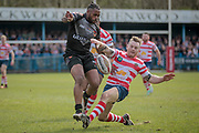 Iliess Macani (Bradford Bulls) is stopped by the Oldham Roughyeds player during the Kingstone Press Championship match between Oldham Roughyeds and Bradford Bulls at Bower Fold, Oldham, United Kingdom on 2 April 2017. Photo by Mark P Doherty.