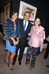 Left to right, PAOLA PAVLOV, CHRISTOS ZAMPOUNIS and ? at a party to celebrate the publication of Elena Makri Liberis's book 'Every Month, Same day' held at Sotheby's, 34-35 New Bond Street, London on 5th May 2009.