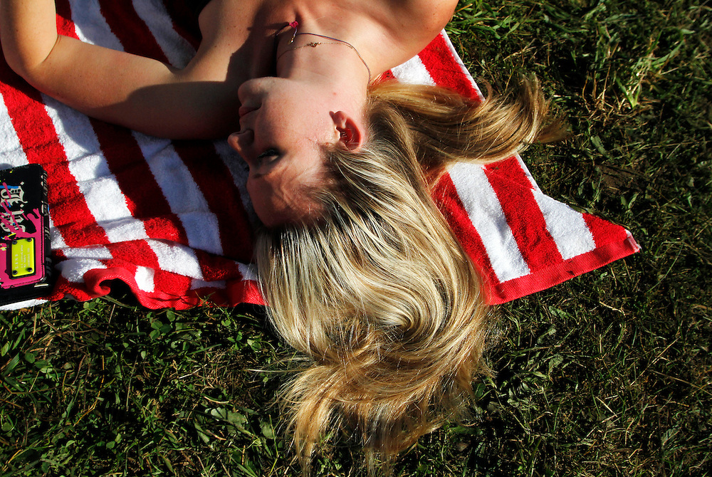 Lauren Morhard, 29, of Philadelphia, enjoys the sun while at her campsite with friends at The 2013 Electric Forest Festival at The Double JJ Ranch in Rothbury Mich., on June 28, 2013.