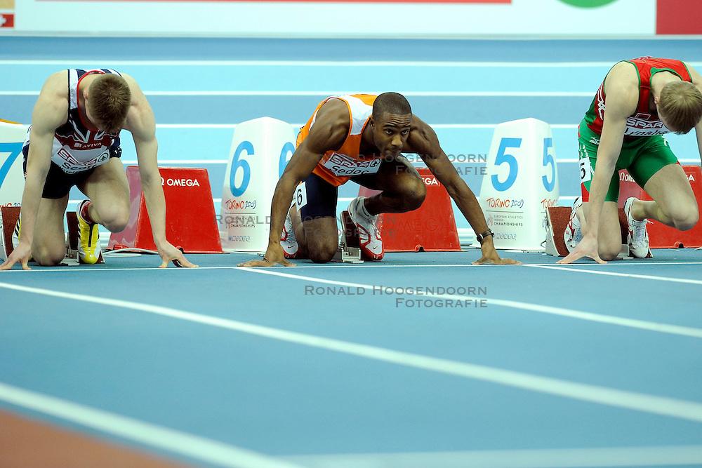 06-03-2009 ATLETIEK: EK INDOOR: TURIJN <br /> Gregory Sedoc wint de zilveren medaille op de 60 meter horden - start<br /> &copy;2009-WWW.FOTOHOOGENDOORN.NL