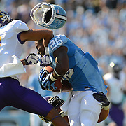 Giovani Bernard (26) of the North Carolina Tar Heels gets hit by Lamar Ivey (7) of the East Carolina Pirates on August 9th, 2012 at Kenan Stadium in Chapel Hill , North Carolina.