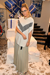 AMBER LE BON at a party to celebrate 'Kitmas' at Kit & Ace at 80-82 Regent Street, London on 9th December 2015.