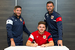 Bristol City Head Coach Lee Johnson and Assistant Head Coach Jamie McAllister look on as Charlie Harris signs a new contract with Bristol City Under 23s ahead of the 2017/18 Season - Rogan/JMP - 11/07/2017 - Ashton Gate Stadium - Bristol, England.