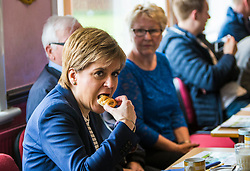 First Minister Nicola Sturgeon campaigns at Liberton Bowling Club in Edinburgh with local candidate, Jim Eadie