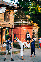 Young children practice martial arts on the grounds of the Shree Pashupatinath Temple.