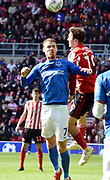 Tom Naylor and Aiden McGeady during the EFL Sky Bet League 1 match between Sunderland and Portsmouth at the Stadium Of Light, Sunderland, England on 27 April 2019.