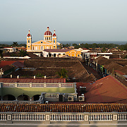 A view out over the city of Granada from the clock tower at Iglesia de la Merced, one of the city's most beautiful and historic churches. Iglesia de la Merced is regarded as one of the most beautiful of Granada's churches. It was originally built in 1539, but in subsequent centuries it was destroyed or damaged and rebuilt several times. The current baroque facade dates to 1783. The church's most recent renovation came after being being damaged by William Walker's men in 1854, with the restoration done in 1862.