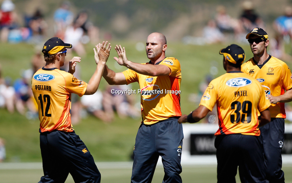 Firebirds Luke Woodcock celebrates the wicket of Brendon McCullum during the Twenty20 Cricket - HRV Cup, Otago Volts v Wellington Firebirds, Saturday 31 December 2011, Queenstown Events Centre, Queenstown, New Zealand. Photo: Michael Thomas/photosport.co.nz