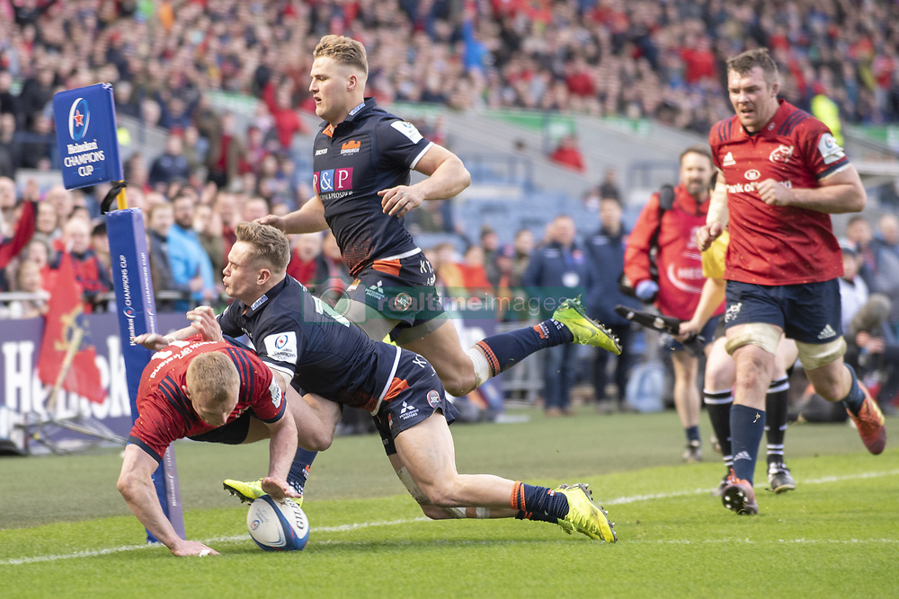 March 30, 2019 - Edinburgh, Scotland, United Kingdom - Keith Earls of Munster scores a try during the Heineken Champions Cup Quarter Final match between Edinburgh Rugby and Munster Rugby at Murrayfield Stadium in Edinburgh, Scotland, United Kingdom on March 30, 2019  (Credit Image: © Andrew Surma/NurPhoto via ZUMA Press)