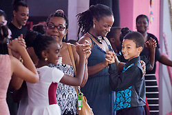 Mahsai Meyers dances the Merengue with mom Monique Meyers at the Juanita Gardine Elementary School Dancing Classrooms VI Culminating Event.  16 December 2015.  Christiansted, St. Croix.   © Aisha-Zakiya Boyd