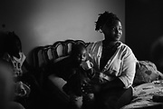 "BIRMINGHAM, AL – MAY 20, 2016: Marquita Smiley, 33, holds her 2-year-old son, Zaidan.<br /> <br /> While pregnant in 2014, Marquita Smiley was prescribed Zofran to help her cope with severe morning sickness. At her 20 week ultrasound, the OB/GYN discovered signs that her son was suffering from hypoplastic left heart syndrome – a rare heart defect resulting in a severely underdeveloped heart. Months later, her newborn Zaidan was placed on a transplant list, and he ultimately underwent surgery as a 2-month-old to replace the failed organ.<br /> <br /> Initially developed as a drug to help cancer patients suffering from the side-effects of chemotherapy, Zofran (generic name ondansetron) has become widely prescribed by doctors to treat morning sickness among pregnant mothers. Pharmaceutical companies point to studies that deny any link between the drug and birth defects, yet somehow ondansetron has avoided the strict barrier of clinical trials required by the Food and Drug Administration to validate its use among pregnant women. Absent of any data, critics argue that pregnant women and their babies are susceptible to unknown risks.<br /> <br /> It wasn't until months after Zaidan's heart transplant that the Zofran controversy was brought to Marquita Smiley's attention. ""Mentally more than anything it was life changing,"" Smiley said. ""We watched him code several times, so I really don't want anybody to have to experience this. If [the drug] is what caused it, people need to know what they're getting into."""