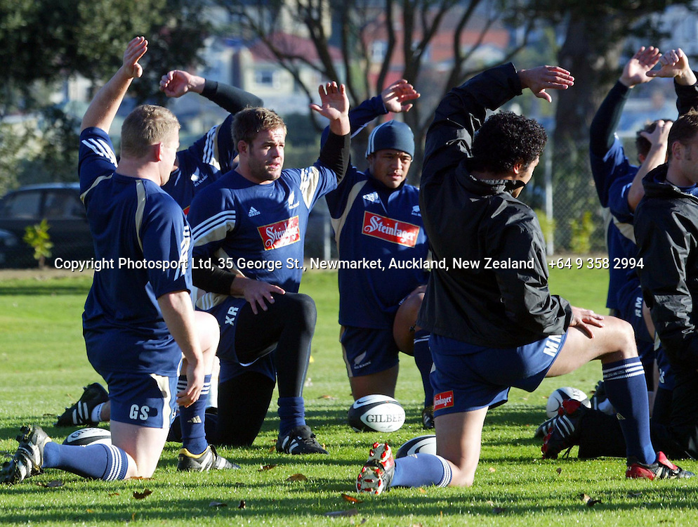 Xavier Rush and Keven Mealamu warm up alongside other team mates during an All Black Training, 07 June 2004 in Dunedin, prior to the Test match against England on Saturday.<br />