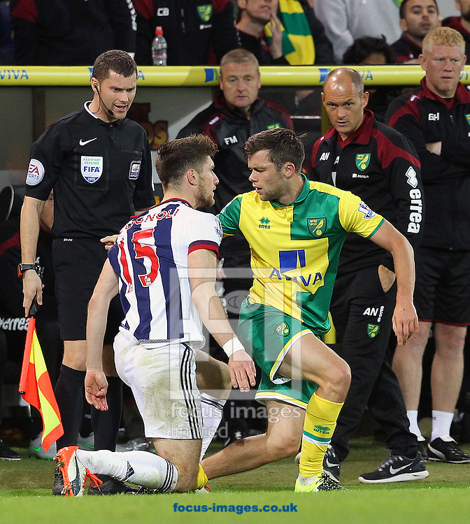 Tempers flare between Sebastien Pocognoli of West Bromwich Albion and Jonny Howson of Norwich during the Capital One Cup match at Carrow Road, Norwich<br /> Picture by Paul Chesterton/Focus Images Ltd +44 7904 640267<br /> 23/09/2015