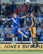 Rhys Oates (Hartlepool United) wins the high ball from Josh Coulson (Cambridge United) during the Sky Bet League 2 match between Hartlepool United and Cambridge United at Victoria Park, Hartlepool, England on 19 September 2015. Photo by George Ledger.