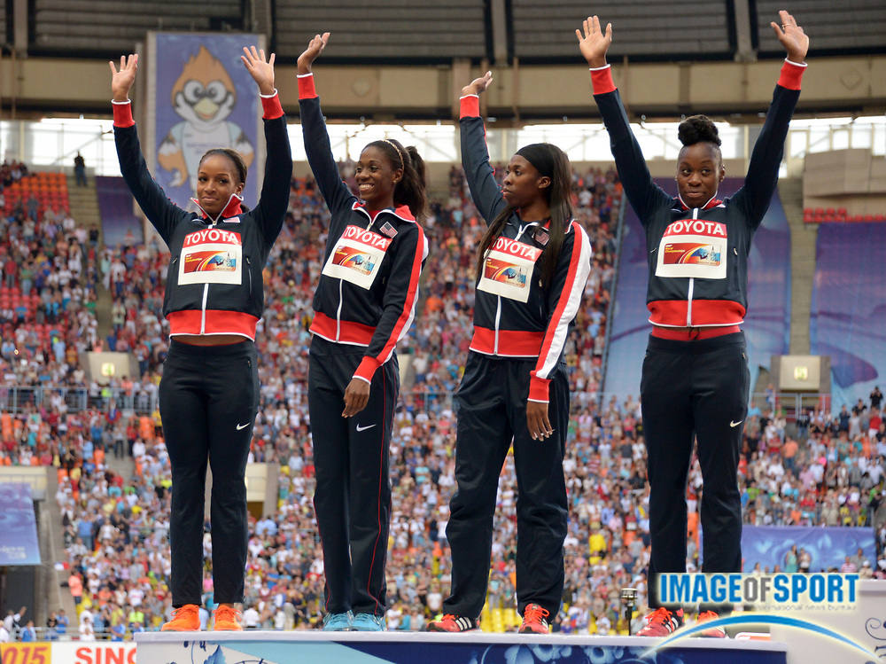 Aug 17, 2013; Moscow, RUSSIA; Members of the United States womens 4 x 400m relay team pose with silver medals after placing second in 3:20.41 in the 14th IAAF World Championships in Athletics at Luzhniki Stadium. From left: Francena McCorory and Jessica Beard and Natasha Hastings and Ashley Spencer.